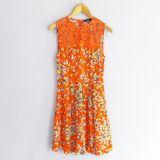 Vestido naranja de flores