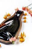Fuente mediana hecha de botella de vino reciclada
